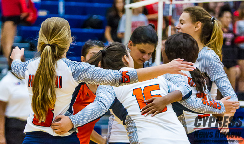 Emily Adams, Jessica Frannea, Alyssa McMorris, Makensie Garner and Katie Kessler celebrate Aidan Conner's point moments earlier, during CFISD HS #12's season opener Tuesday. The CFISD HS #12 Bears volleyball team fell to Clear Brook in the program's first varsity match, 29-27, 25-18, 25-23, Aug. 7, 2018. (Cypress News Review photo by Creighton Holub)