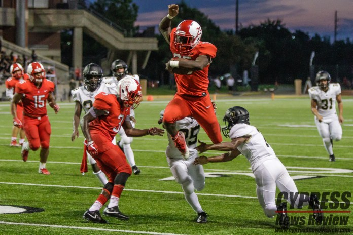 Sean Hunter leaps to avoid Jonovan Eichelberger (7) and Carl Jenkins (25) while Quintavien Smith (red 3) works his way into the fray. The Cy-Lakes Spartans defeated the Cy-Park Tiger football team, 54-7, at the Cy-Fair FCU Stadium Sat., Sept. 15, 2018. (Cypress News Review photo by Creighton Holub)