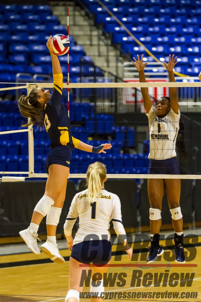 Michelle Klein (Cy Ranch #13) spikes the volleyball, with Karli Rose (Tomball Memorial #1) jumping for a block attempt, during the intra-district playoff, and the effective district championship at the Berry Center Oct. 26, 2018. Both Rose and Klein earned honorable mention spots on the Texas Sports Writers Association's 2018 All-State team. (Cypress News Review photo by Creighton Holub)