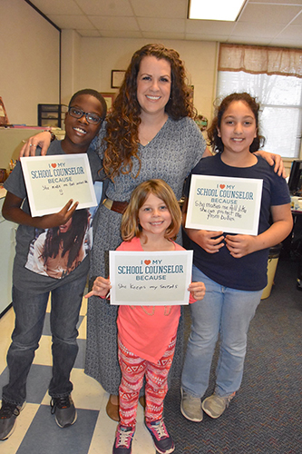National School Counseling Week honors counselors and provides recognition for their impact in helping students. Such was the case with Mariah Nomura (top center), Copeland Elementary School counselor, as she poses for a photo in 2017 with current and former Copeland students. (CFISD Courtesy photo)