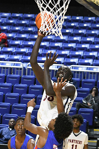 Cypress Springs High School senior Bonke Maring (top) and the Panthers advanced to the area round following a 63-49 win over Round Rock McNeil. They will face Klein Forest at 7 p.m. on Feb. 22 at Tomball High School. (CFISD courtesy photo)