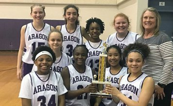 """The Aragon Middle School eighth-grade girls' basketball A team poses after winning the CFISD Middle School """"A"""" Basketball Tournament Gold Bracket, held Feb. 16 at Aragon Middle School. (CFISD courtesy photo)"""
