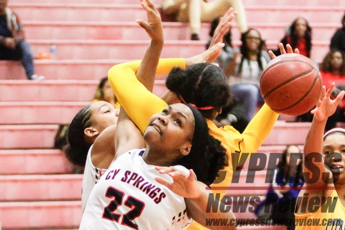Emari Sidney (Cy Springs 22) gets tangled up during a recent game with 14-6A district champion Cy Ranch. (Cypress News Review photo by Creighton Holub)