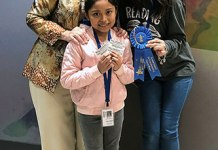 Bane Elementary School third-grade student Brianna Zetina (middle) poses with Dr. Carrie Marz (left), Bane principal, and third-grade teacher Victoria Valentin. Zetina was selected as a winner of the Houston Livestock Show and Rodeo's Houston General Go Texan decorating contest, earning a blue ribbon and passes to the show and rodeo for her decorated cowboy hat, which will be on display during the rodeo. (CFISD courtesy photo)