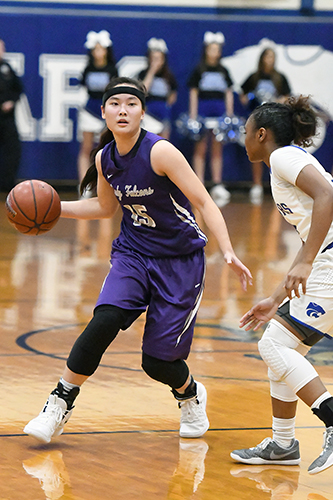 Jersey Village High School senior Kayleigh Truong (left) was among five CFISD basketball standouts to earn all-state accolades by either the Texas Association of Basketball Coaches or the Texas Girls Coaches Association. Truong and her twin sister, Kaylynne Truong, were named all-state by both organizations. (CFISD courtesy photo)