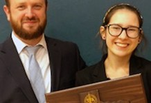 Cypress Creek High School junior Ivey Knebel (right) celebrates her second-place finish in Poetry Interpretation with Dustin Kay, Cypress Creek debate teacher and coach. Knebel was the highest-finishing CFISD student at the Texas Forensic Association State Championship, held March 14-16 at Alief Taylor High School. (CFISD courtesy photo)