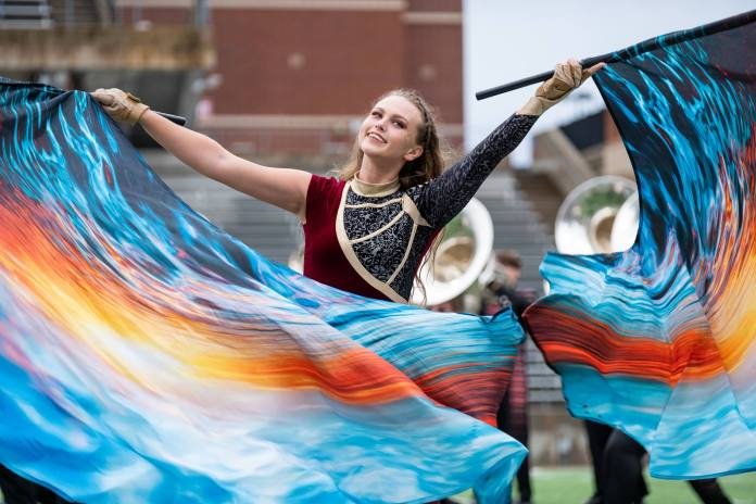 A Cy-Fair color guard member performs. (Courtesy photo)