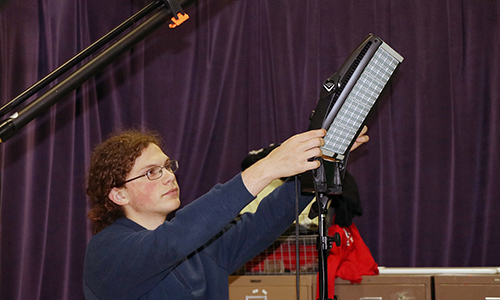 Jersey Village High School junior Kaleb Velez sets up LED lights for a promotional shoot for Jersey Village English teacher Holly Charles. Velez was among 25 students across the country selected to attend and participate in the PBS Student Reporting Labs Academy from June 22-28 in Washington D.C., where he will work alongside public media mentors to produce original digital content. (Photo by Ivy Hansen, Jersey Village HS, courtesy CFISD)