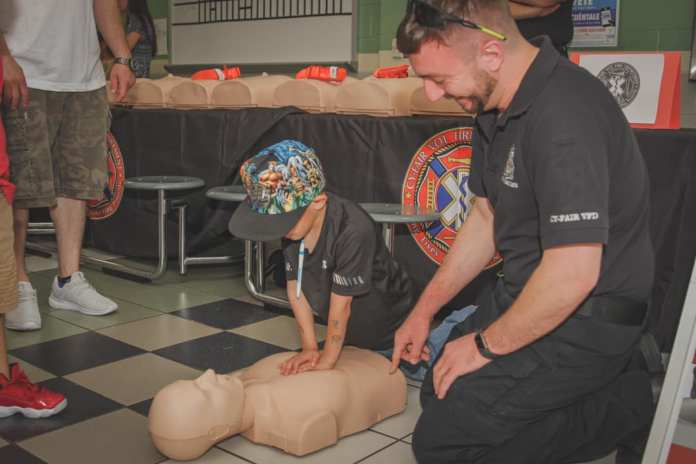 Cy-Fair EMS Training Division teaches Hands-Only CPR to parents and students at Cypress-Fairbanks ISD Duryea Elementary School during their Spring Festival on Saturday, April 27th, 2019. (CFVFD courtesy photo by Lt. Daniel Arizpe, PIO)