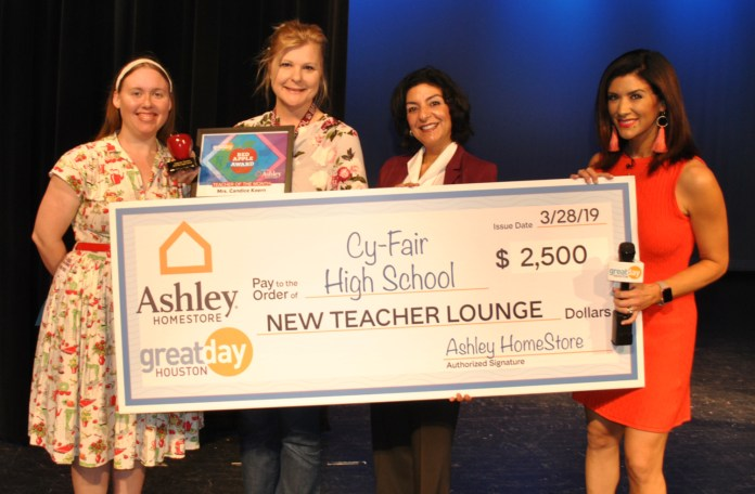 Cy-Fair High School Theater Arts teacher Candice Koern (second from left) stands proudly with her Red Apple Award along with (l. to r.) former student Brittney Greene, Ana Martin, school principal; and KHOU Great Day's Cristina Kooker. (courtesy photo)