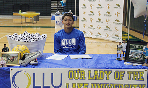 Cypress Falls High School senior Chris Zepeda signed a letter of intent May 1 to Our Lady of the Lake University. (Photo by Kevin Ramos, Cypress Falls HS)