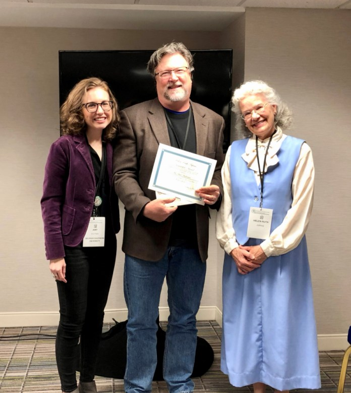 Lone Star College-CyFair's Geography Professor Buck Buchanan received the Helen Ruth Aspaas SAGE Innovator Award. From left are Dr. Amy Potter, Chair, American Association of Geographers (AAG) Stand-Alone Geographers (SAGE) Affinity Group; Buchanan, and Dr. Helen Ruth Aspaas. (LSC courtesy photo)