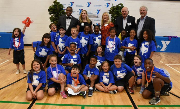 From left to right: Khambrel Marshall, Board Chair YMCA of Greater Houston, Nanci Rutledge, Vice President of Major Gifts YMCA of Greater Houston, Pam Stanton and Charlie Reed The Hammill Foundation, Stephen Ives, President and CEO YMCA of Greater Houston and YMCA Day Campers. (Courtesy photo)
