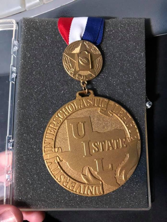 A Texas football state championship medal, particularly for the Class 3A victory stemming from Sealy, Texas, in 1997.