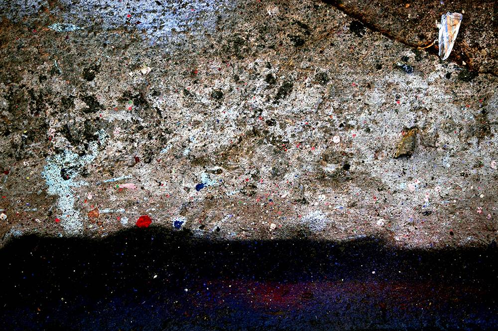 Abstract color photograph featuring black, beige, cream, yellow, red, cyan, blue, purple, green, and gray.