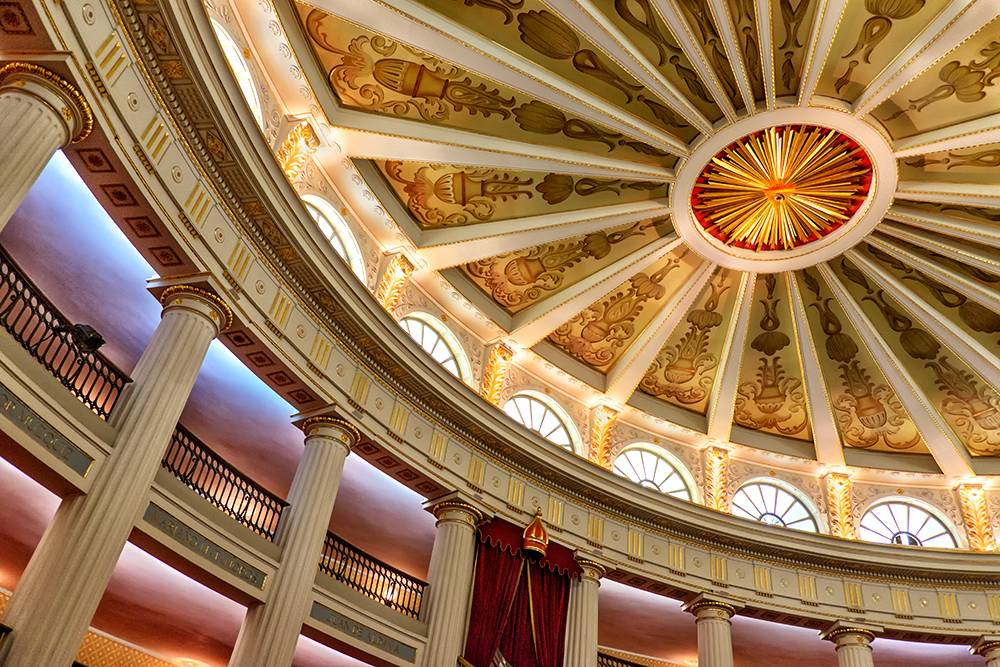 Color photo of an ornate, 19th century domed ceiling.
