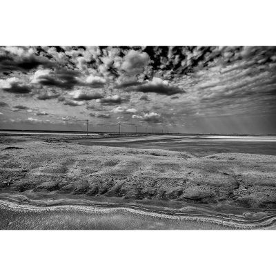 Clouds float above the barren landscape at the Manaure Salt Flats in La Guajira, Colombia.