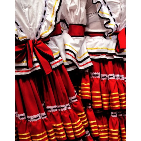 Girls in red traditional dresses attend a festival in Libano, Colombia.