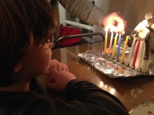 The Monster watching the Hanukkiah being lit