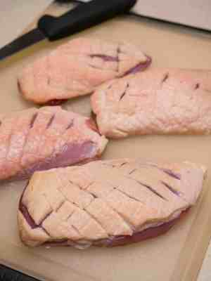 Scoring the duck breasts
