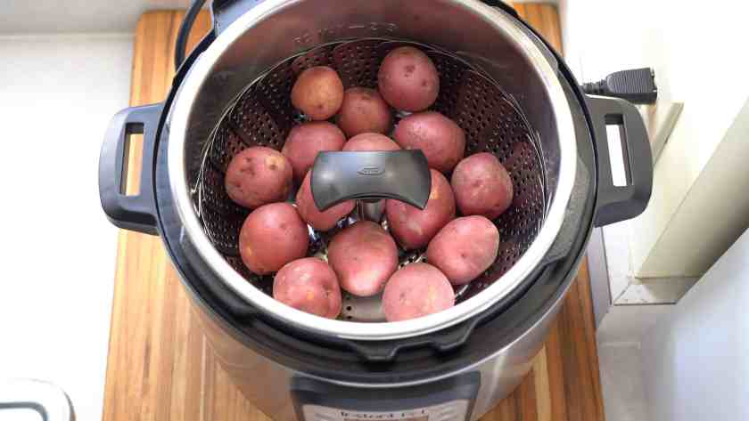 New potatoes in a steamer basket in an Instant Pot