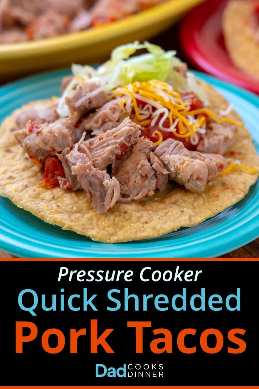 Pork taco topped with salsa, shredded cheese, and shredded lettuce on a teal plate, above text saying Pressure Cooker Quick Shredded Pork Tacos