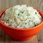 An orange bowl full of cilantro lime rice