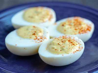 Deviled Eggs on a dark blue plate