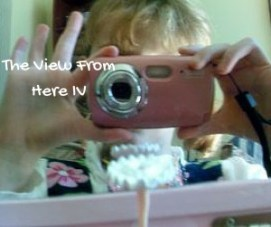 The View From Here - a kid taking a photo of herself in the mirror