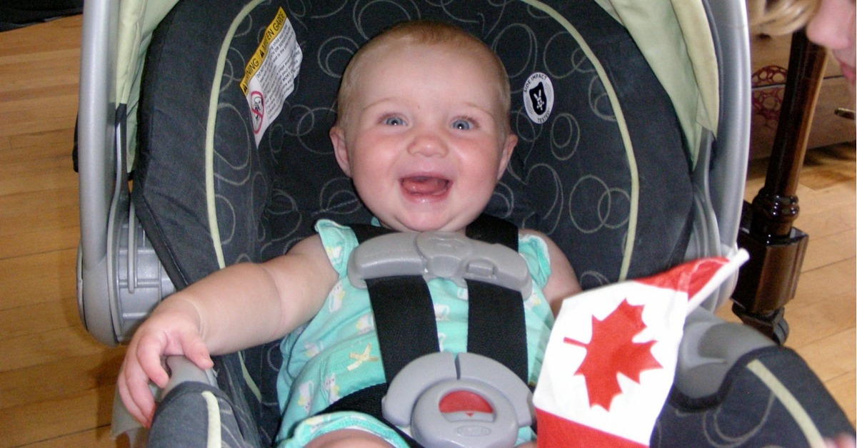 Image of a baby with a Canada Flag