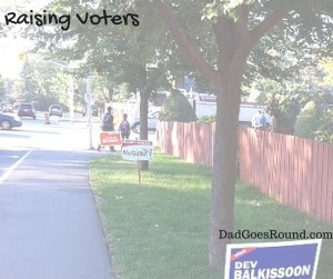 "Image of election campaign signs with text ""raising voters"""