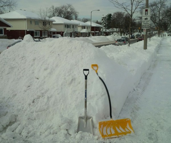 Image of snow pile at the end of a driveway