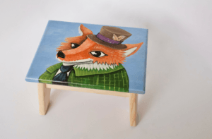 Image of a step stool decorated with a hand-painted fox
