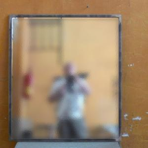 Espejo Due en hierro natural barnizado 100x80