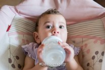Wide-eyed baby with a bottle - Dadtography