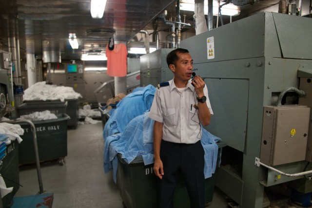 Behind the Scenes Ship Tour - Tour guide narrates laundry process.