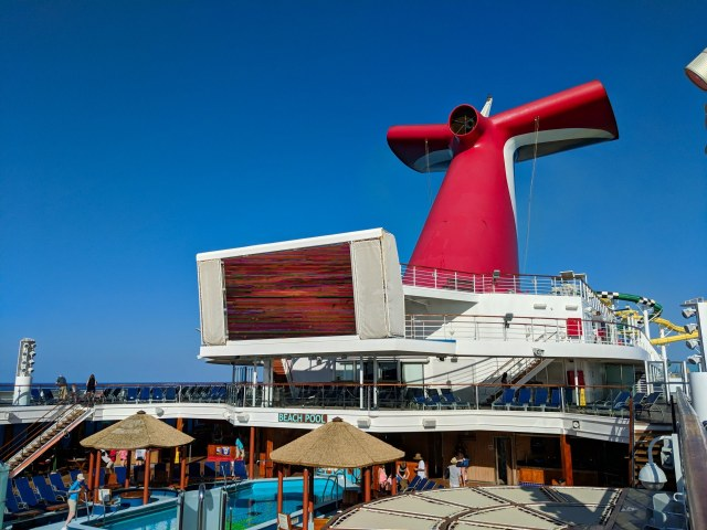 Iconic ship's whale tail smoke stack and pool deck on the Carnival Sunshine Ship