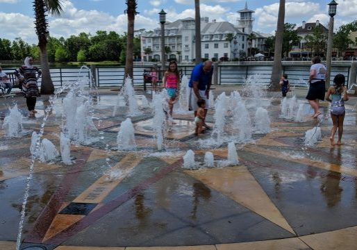 Kids playing in the splash pad during the Celebration Exotic Car Show 2018