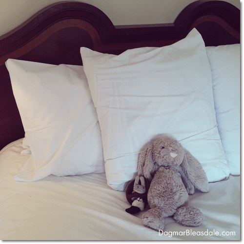 stuffed animals on hotel bed