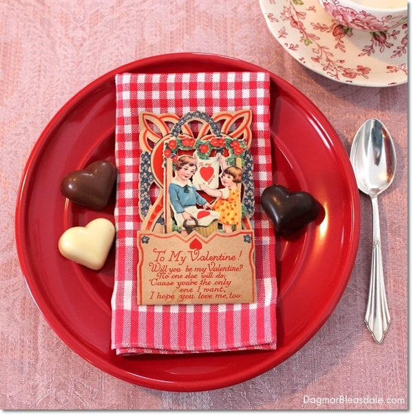 Valentine's Day table setting with vintage Valentine's cards