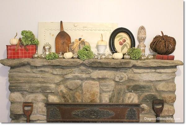 fall decor on mantel with dried hydrangeas
