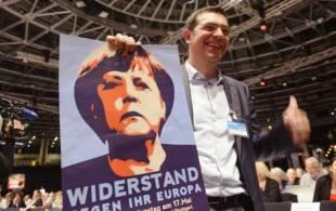 tsipras con un poster della merkel