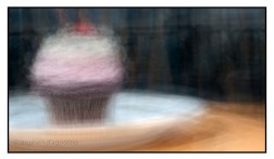 A photo impressionistic take on the cupcake. A Prairie Girl cupcake photographed in the round as an example of photo impressionism. © Stephen D'Agostino