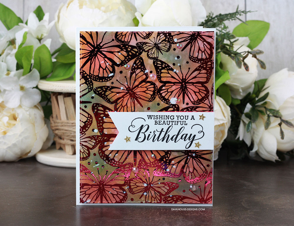 Sharing a card idea with a tutorial and quick video using a ThermOWeb Toner Card front designed by Unity Stamp Company. Blending Distress Inks in the background and foiling on top makes for one beautiful background for a birthday card. More inspiration on dahlhouse-designs.com. #cardmaking #cardmaker #cards #stamping #dahlhousedesigns #unitystampco #thermoweb #foiling #distressink #timholtz #distress #birthdaycard #handmadecards #diecutting #diy #carddesign #cardcraft #decofoil