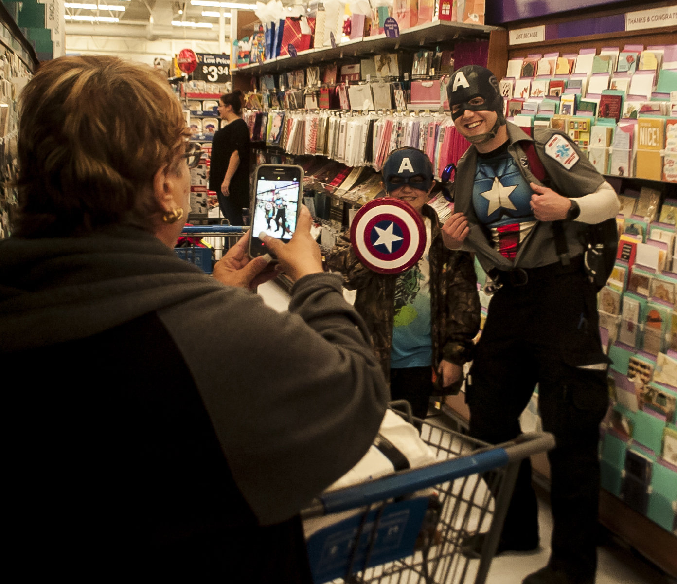 MetroAtlanta's Beau Witcher, right, came dressed as Captain America to shop with Mathea Chambers at Saturday's Shop with a Hero event at Walmart.