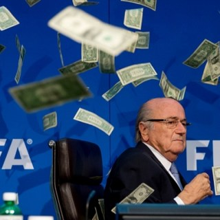 PHOTO from FIFA Office Headquarters as Comedian Simon Brodkin throws cash at FIFA President S. Blatter