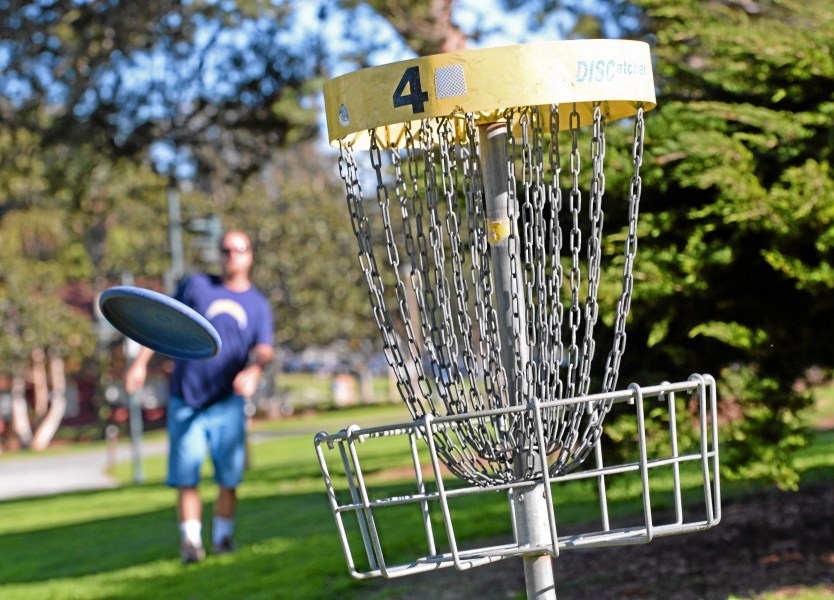 Woman disfigured in park disc golf incident suing Manhattan Beach     Sam Guard makes a short toss to the fourth hole on the nine hole disc golf  course at Polliwog Park in Manhattan Beach