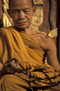 A Monk With Mala Beads
