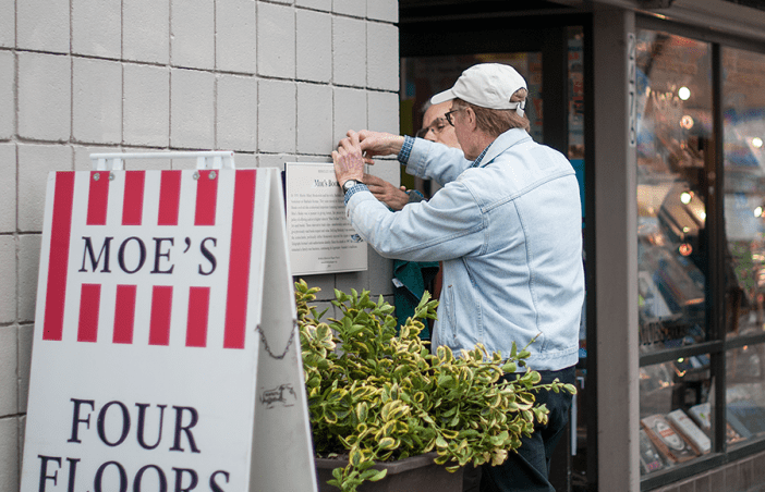 Members of the Berkeley Historical Plaque project adorned the entrance of Moe's Books with a sign indicating its historical significance in the Berkeley community on Monday afternoon.