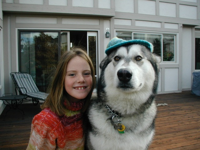 Franklin, 8, with Ruger, the Alaskan Malamute that the only child describes as her little brother.  Dick Franklin/Courtesy